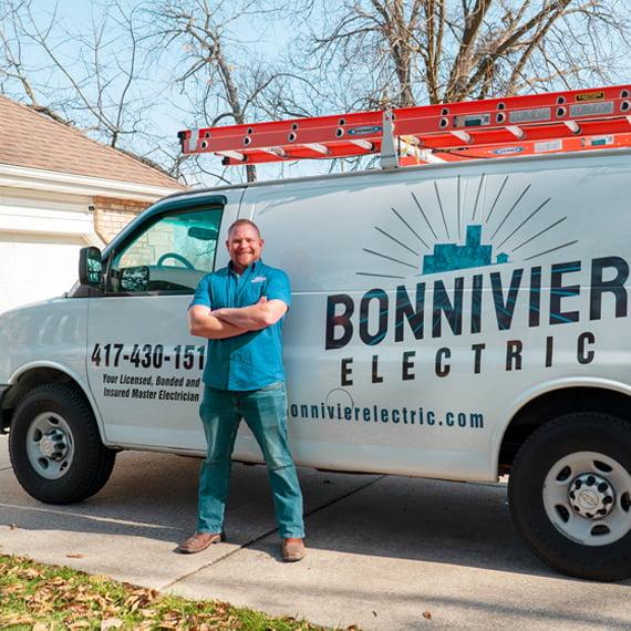 Levi Bonnivier standing next to Bonnivier electric truck